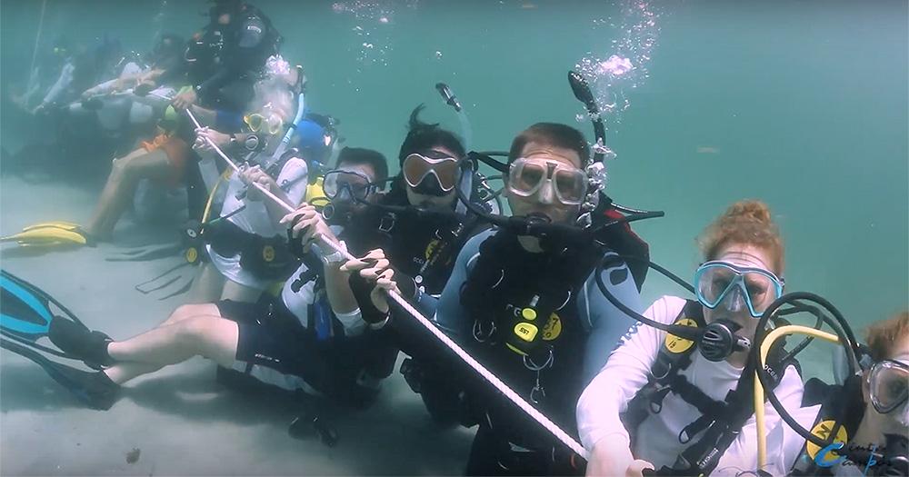 Longest underwater human chain [Ocean]