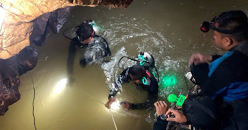 Divers rescue 12 boys and coach from flooded Thai cave